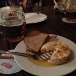 Cheese in oil with bread and beer